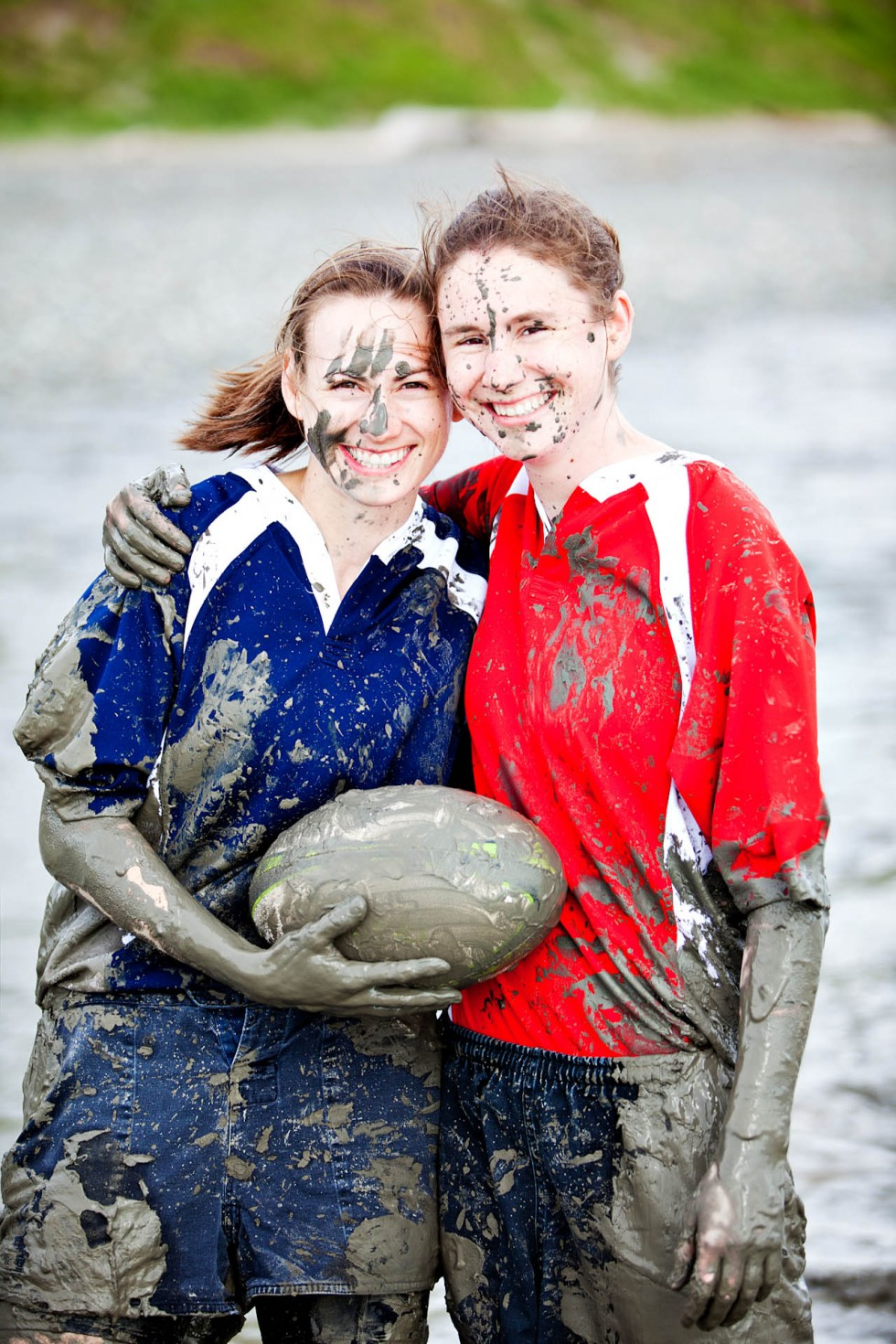 Rugby girls are muddy for their love story portrait session in alaska